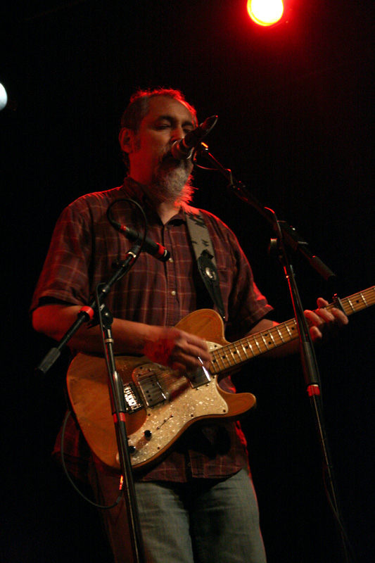 The lead guitarist of the Iguanas sings during their concert.