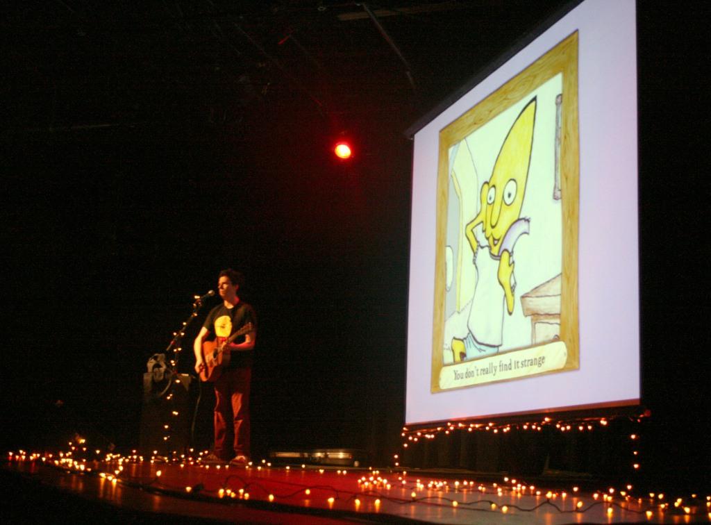 Taylor sings as Gustafer plays with his eel sidekick slim.